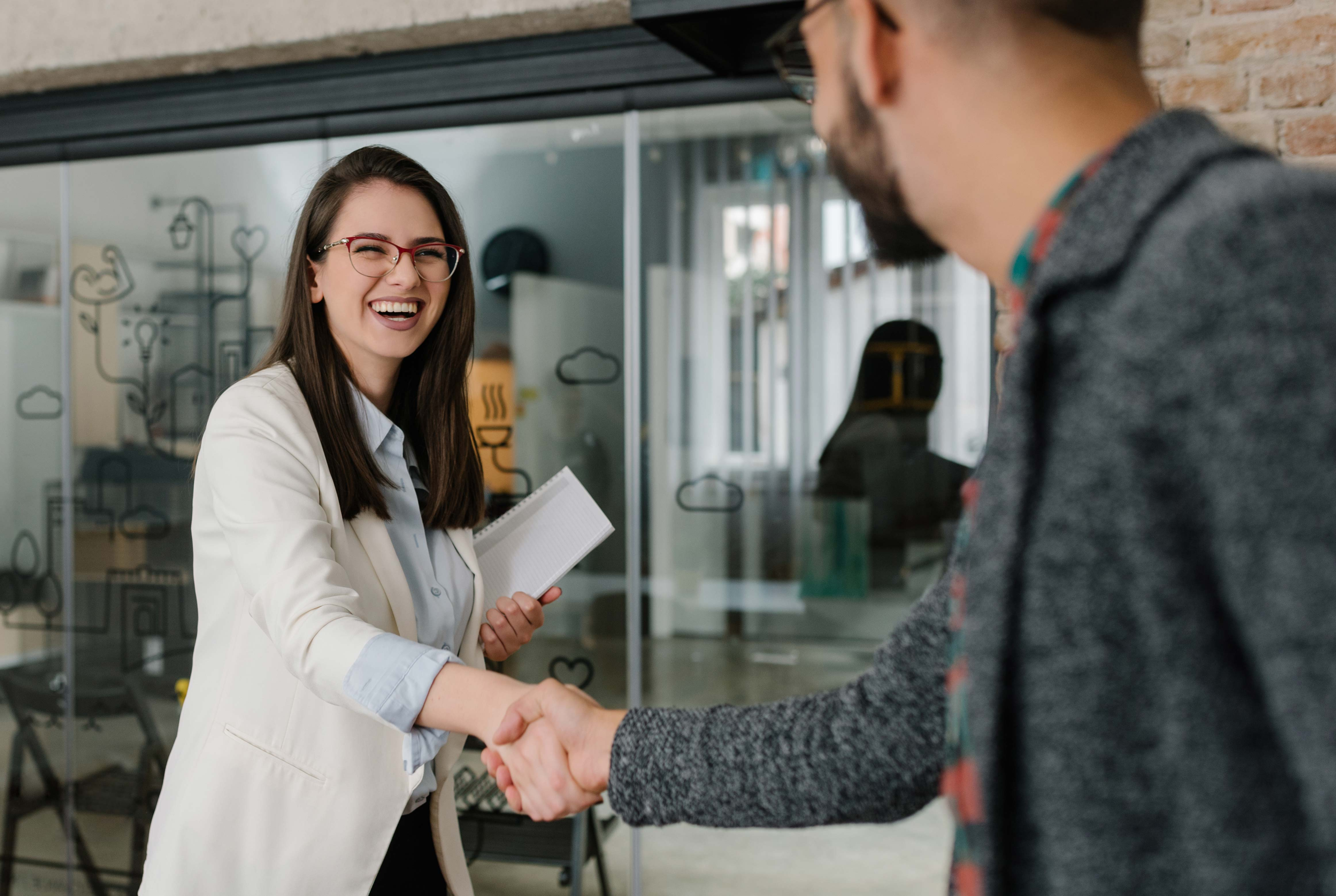 job candidate greeting an employer