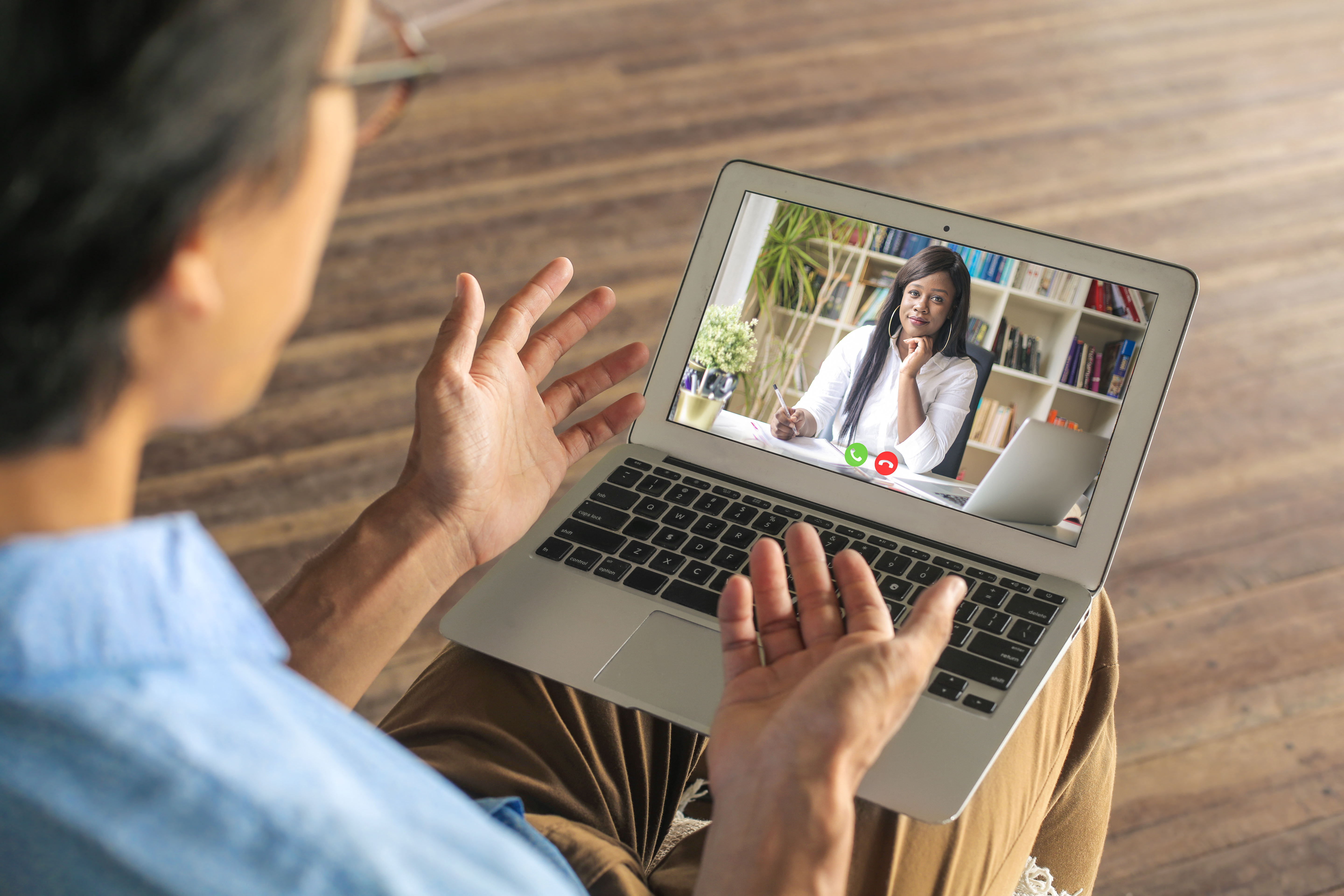 A man using his laptop webcam to speak with a potential employer