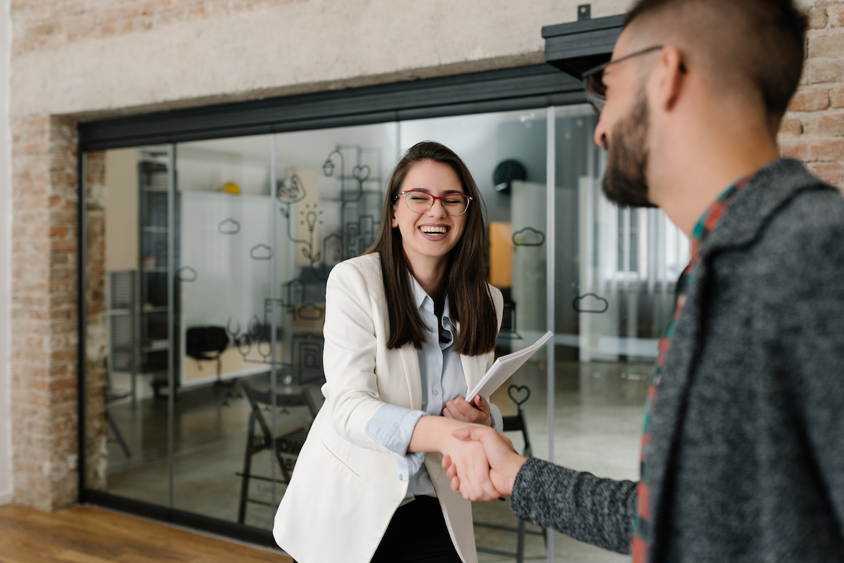 Handshaking and smiling candidly at a job interview